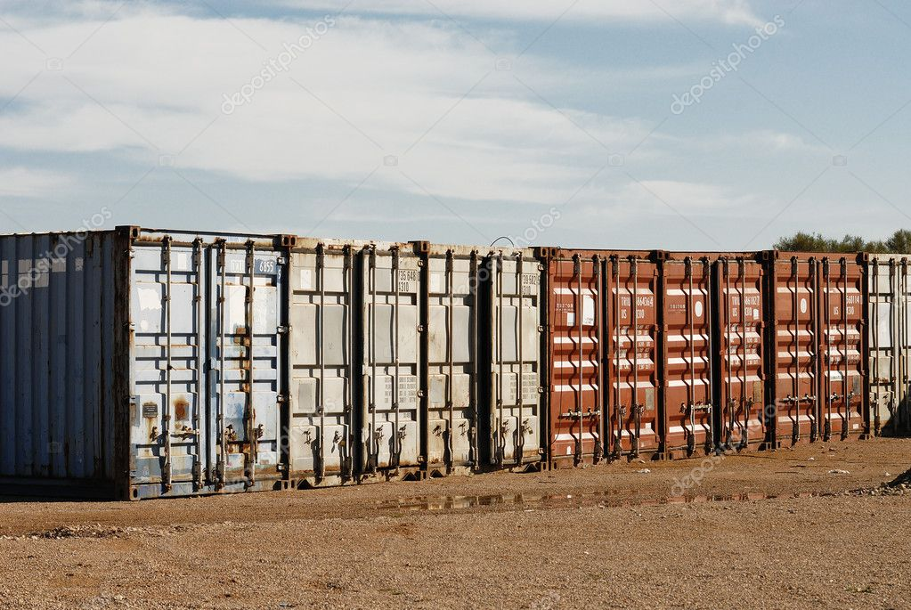 Stacked freight containers awaiting import/export at a commercial dockside.  Photo #5011461