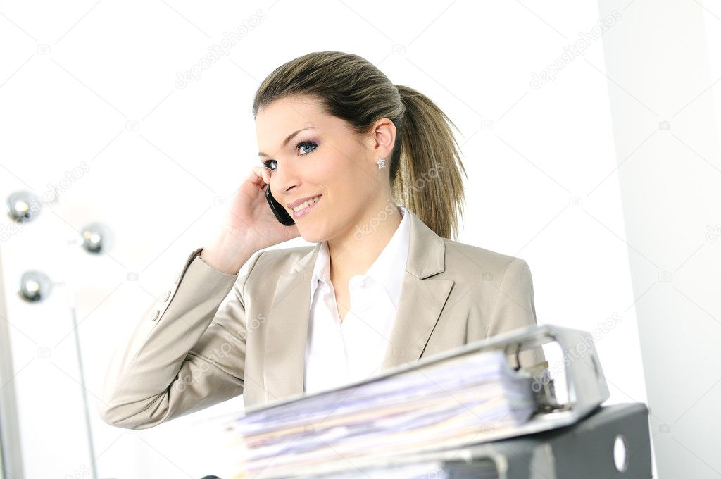 Closeup of businesswoman in the office talking on the phone — Stock Photo #5083575