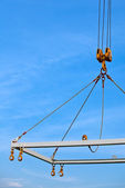 Shipping crane on blue sky background — Stock Photo