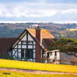 Farmhouse on a hill - Stock Photo
