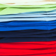 Multicolor sport shirts in store - Stock Photo