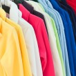 Multicolor sport shirts hanging in store - Stock Photo