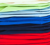 Multicolor sport shirts in store — Stock Photo