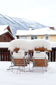 Snow covered chairs and table — Foto de Stock