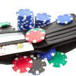 Poker chips in black leather purse - Stock Photo