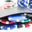 Poker chips in black leather purse — Stock Photo