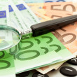 Royalty-Free Stock Photo: Euro Notes with calculator and magnifier