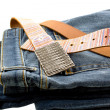 Blue denim jeans and strap leather belt — Stock Photo