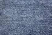 Blue denim background — Stock Photo