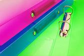Three multicolored folders — Stock Photo