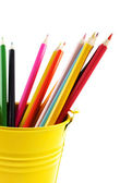 Crayons in yellow bucket — Stock Photo