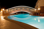 Pool of Greek hotel at night — Stok fotoğraf