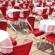Street cafe with red chairs — Stock Photo