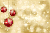 Christmas ornaments on a gold background — Stock Photo