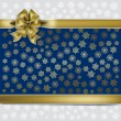 Christmas gold gift ribbon on a snowflakes background — Cтоковый вектор