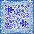 Abstract cracked blue background with floral ornament - Stockvectorbeeld
