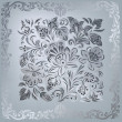 Abstract silver floral ornament on grey background — Stock Vector
