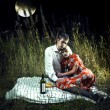 Lovers in the moonlight picnic — Stock Photo