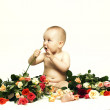 Baby and roses — Stock Photo