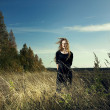 Woman in wheat field - Foto Stock