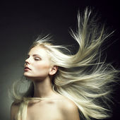 Beautiful woman with magnificent hair — Stok fotoğraf