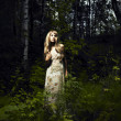 Girl in fairy forest - Stock Photo