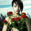 Girl in flower meadow — Stockfoto