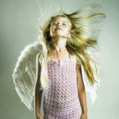 Beautiful happy girl with angel wings — Stock Photo