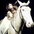 Beautiful girl and white horse — Stock Photo #4227015
