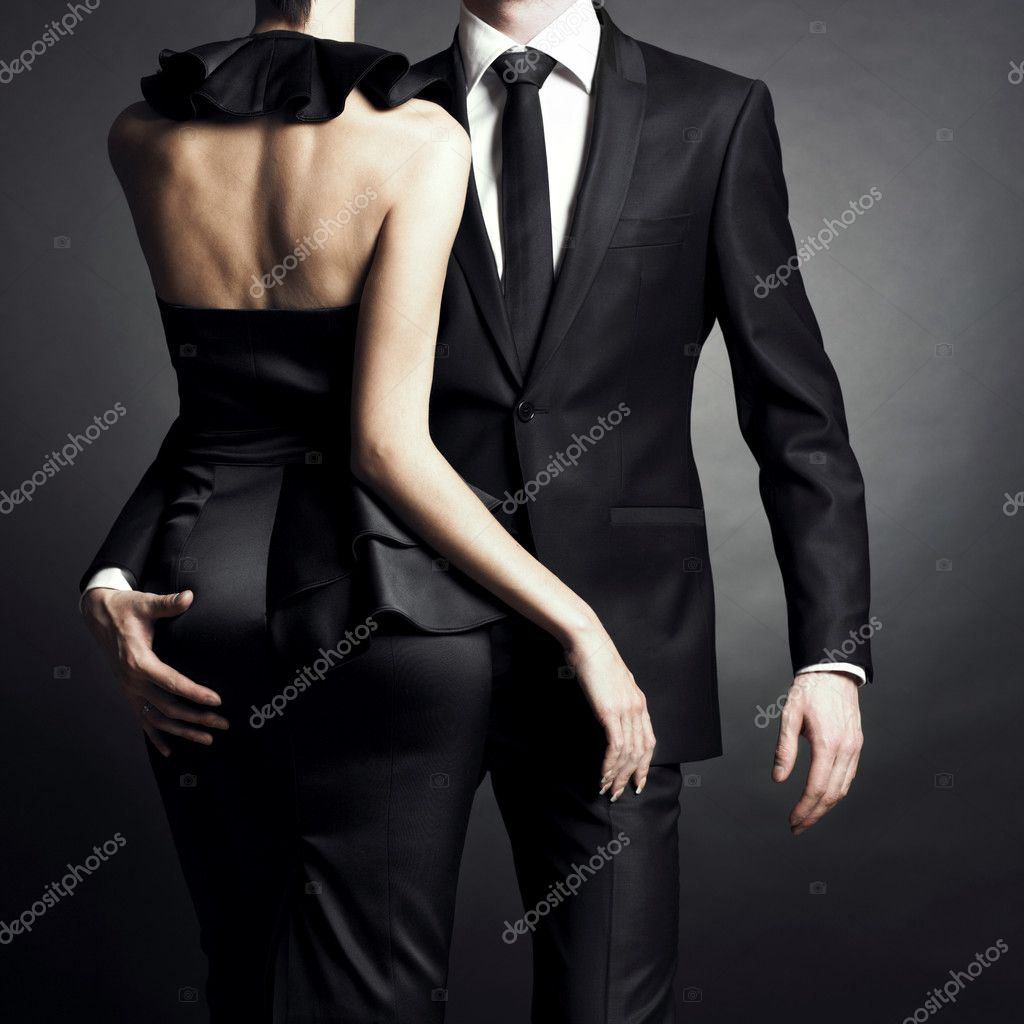 Conceptual portrait of a young couple in elegant evening dresses  Lizenzfreies Foto #4289033