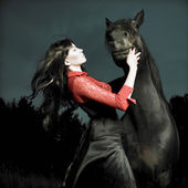 Beautiful girl and horse — Stock Photo