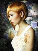 Beautiful girl painter — Stock Photo