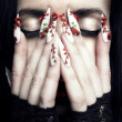 Beautiful woman with long designer nails - Stock Photo
