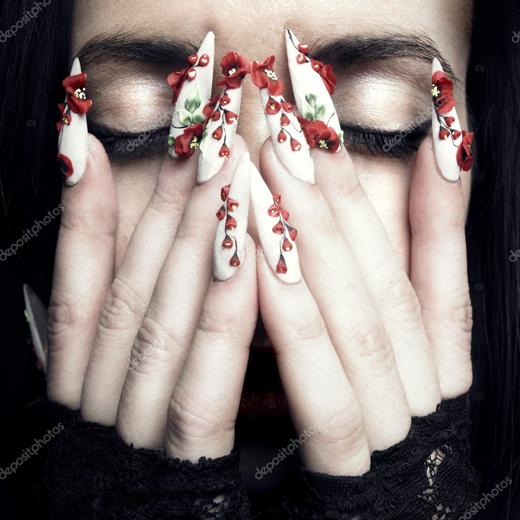 Portrait of a beautiful young woman with long designer nails — Stock Photo #4802786