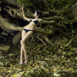 Young brunette beauty in a tropical forest - 图库照片