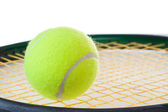 A single tennis ball on a tennis racket — Stock Photo