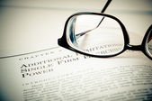 Eye Glasses on a legal book — Stock Photo