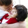 Father kissing his son, three years old — Stock Photo #4300974