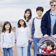 Father with his five children at beach — Stock Photo #4300983