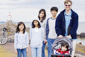 Father with his five children at beach — Stock Photo