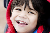 Handsome little boy smiling, closeup — Stock Photo
