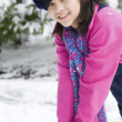 Beautiful twelve year old girl playing in snow — Stock Photo #5107472