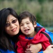 Stockfoto: Asimother and son together at park