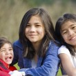 Young siblings together at a park — Stock Photo #5107491