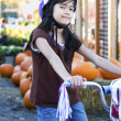 Stock Photo: Little girl with bike helmet on bicycle