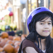 Little girl with bike helmet on bicycle — Stock Photo