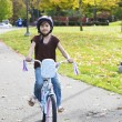 Stock Photo: Little girl riding bike in park