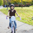 Little girl riding bike in park — Stock Photo