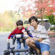 Teen boy with disabled little brother - Stock Photo