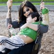 Stock Photo: Mother swinging with her disabled son